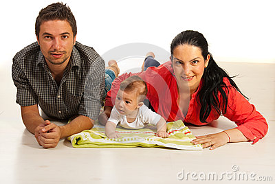 Happy family lying down on floor