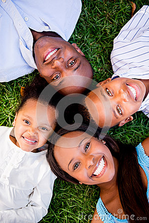 Happy family lying on the grass
