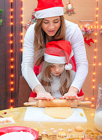 Happy family making Christmas cookies Stock Photo
