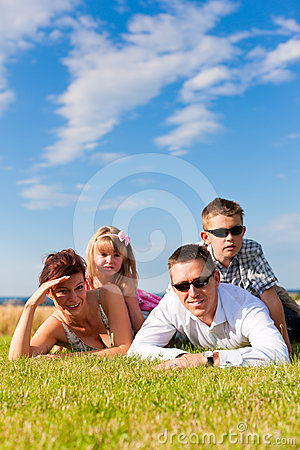 Happy family on a meadow in summer