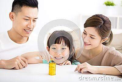 Happy family money saving concept
