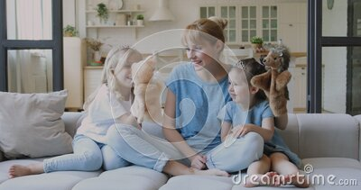 Happy mother and cute little kids daughters playing together stock footage