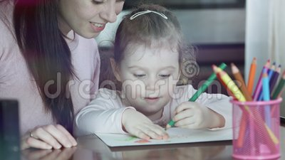 Happy family. Mother and daughter together paint. Adult woman helps the child girl. Happy family. Mother and daughter together paint. Adult woman helps the stock video footage