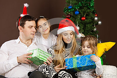 Happy family near the Christmas tree