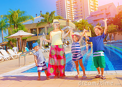 Happy family near pool