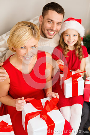 Happy family opening gift boxes