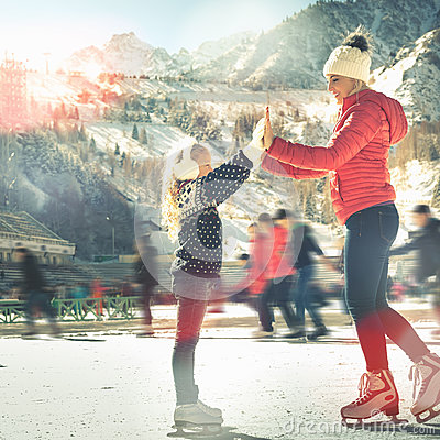 Free Happy Family Outdoor Ice Skating At Rink. Winter Activities Stock Photos - 80524293