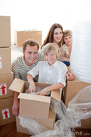 Happy family packing boxes during a removal