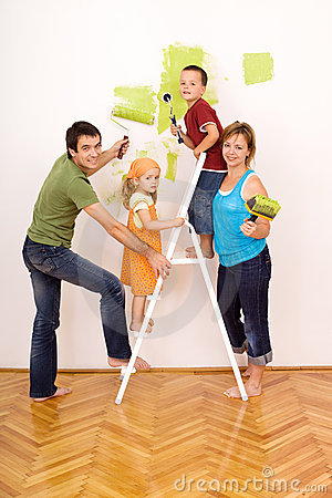 Happy family painting and redecorating