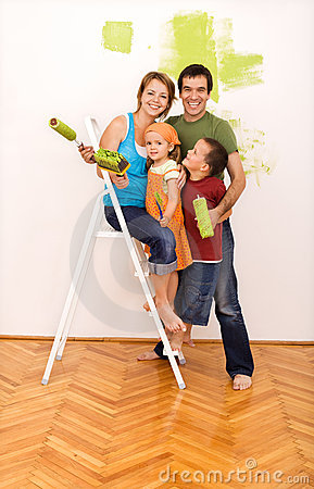 Free Happy Family Painting Their New Home Together Royalty Free Stock Image - 10131006