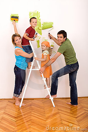 Happy family with painting utensils