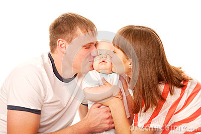 Happy family. Parents kissing the kid