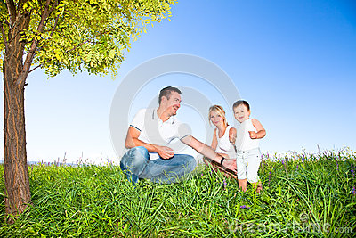 Happy family on picnic in park