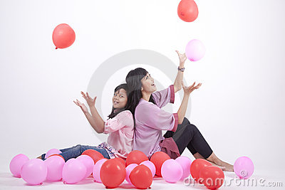 Happy Family playing with balloons