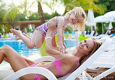 Happy Family In The Pool, Having Fun Stock Photo