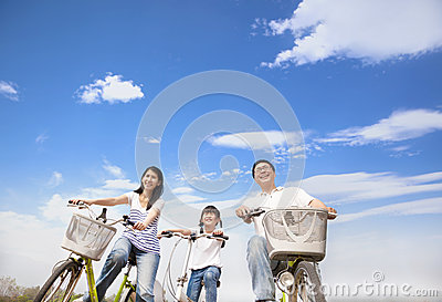 Happy family riding bicycle