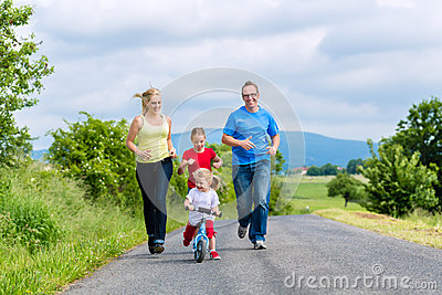 Happy family running for sport on street
