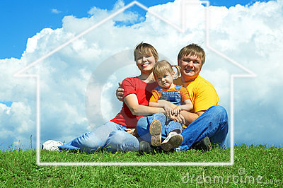 Happy family sit on green grass under sky