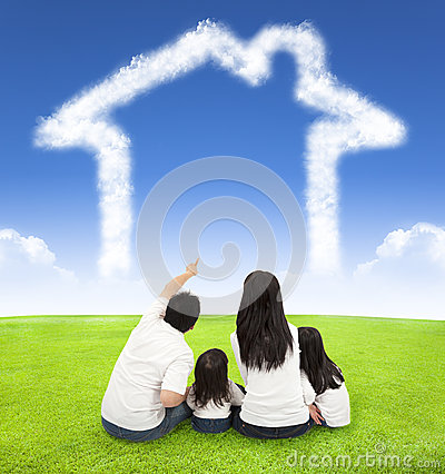 Free Happy Family Sitting On A Meadow With House Of Clouds Royalty Free Stock Photos - 44433938