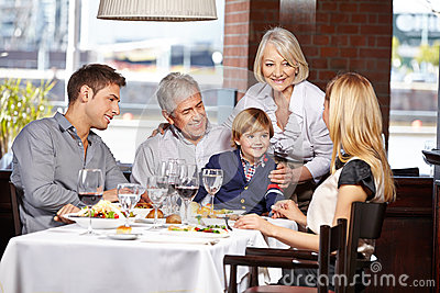 Happy family sitting in restaurant