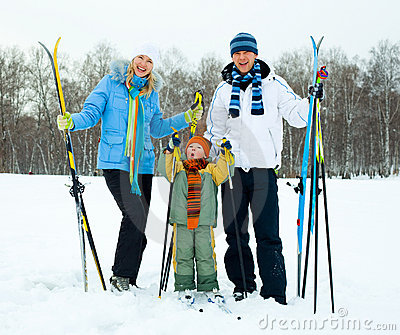 Happy family skiing