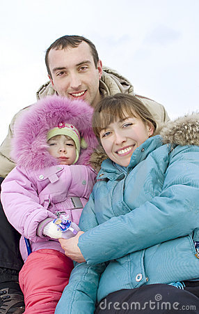 Happy family spending time outdoor in winter