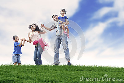 Happy family in summer