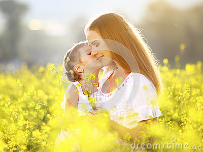 Happy family on summer. little girl child daughter hugging and k Stock Photo