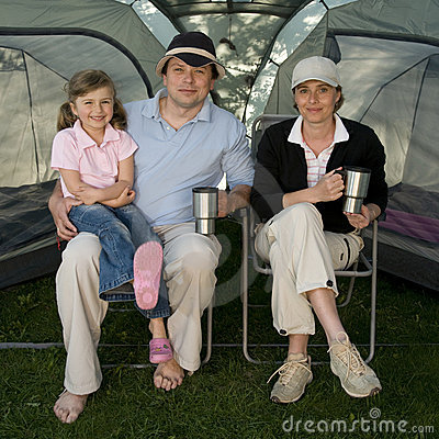Happy family in tent