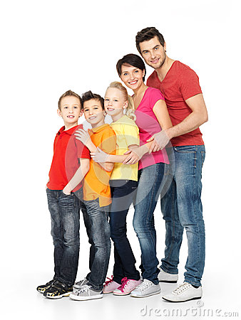 Happy family with three children standing together