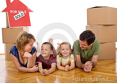 Happy family with two kids in their new home