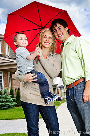 Happy family with umbrella