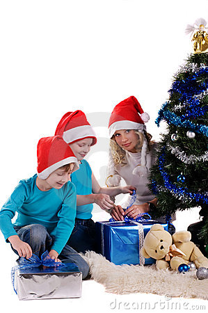 Happy family unwraping christmas gifts