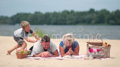 Happy family on vacation realaxing on the beach stock footage