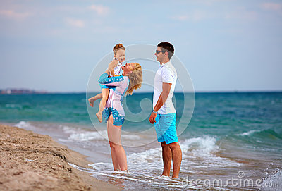 Happy family on vacation, sea beach