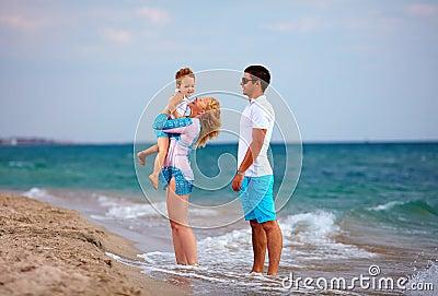 Happy family on vacation, sea beach