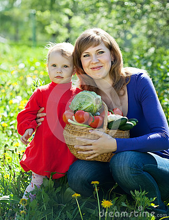 Happy  family with vegetables  in garden