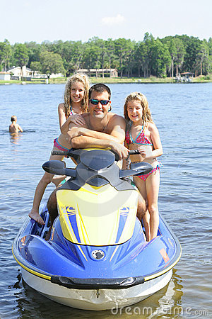Happy family on the water