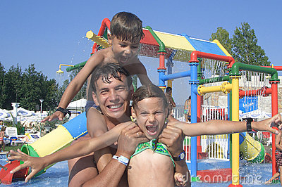 Happy family in the water park