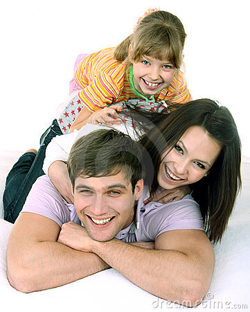 Happy family on white bed.