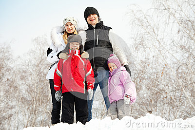 Happy family in winter park