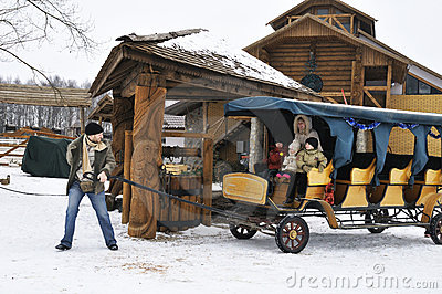Happy family in winter spend time riding cart