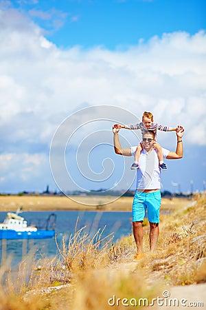 Free Happy Father And Son Enjoying Seaside Landscape Stock Photos - 35848913