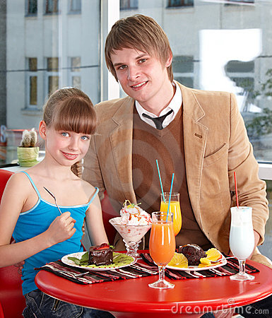 Happy father and daughter in cafe.