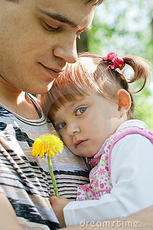 Happy father and daughter outdoor tender portrait