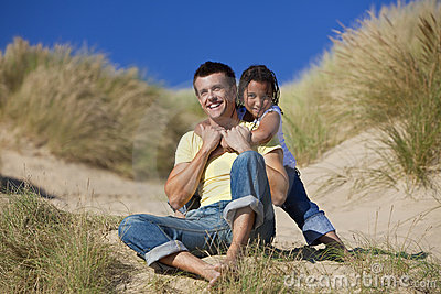 Happy Father and Daughter Playing At Beach