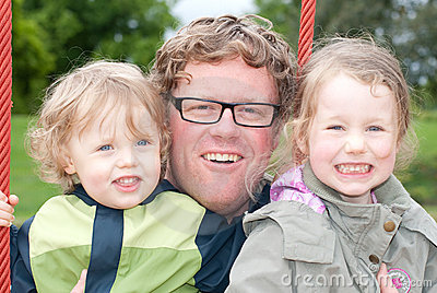 Happy father with daughters
