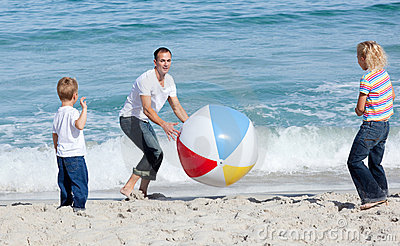 Happy father and his children playing with a ball