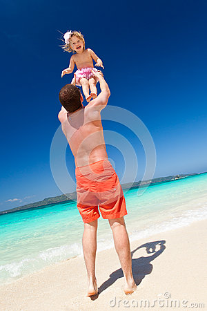 Happy father and little child on beach