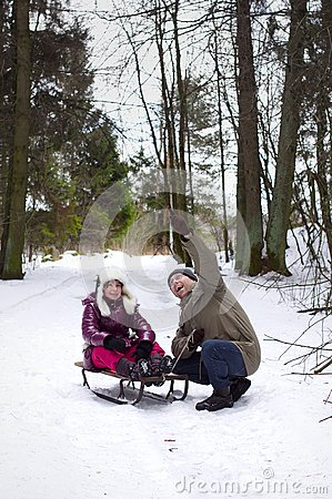 Happy father pointing finger daughter, outdoors